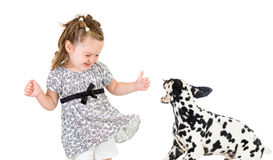 Child girl playing with dog Royalty Free Stock Image