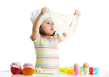 Child girl playing with dough and flour Stock Photos