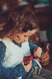Child girl playing with easter eggs and handmade decorations in cozy country house Stock Photography