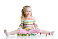 Child girl playing on floor at home Stock Photo