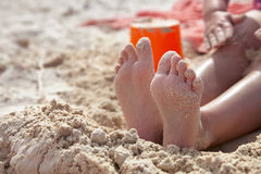 Child girl playing on golden beach sand Stock Photos