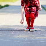 Child girl playing hopscotch on asphalt Stock Image
