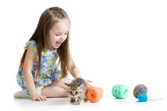 Child girl playing with kitten and balls Stock Image