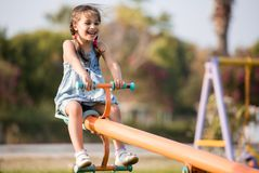 Child Girl Playing At Playground Outdoors. In Summer royalty free stock image
