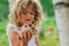 Child girl playing with salt dough cake decorated with flower Stock Photography