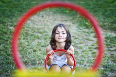 Child girl playing on a swing scales. Stock Images