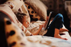 Child girl playing tablet at home Stock Photography
