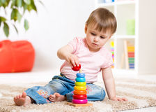 Child girl playing with toy at home Stock Image