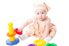 Child girl playing with  toy pyramid Royalty Free Stock Photo