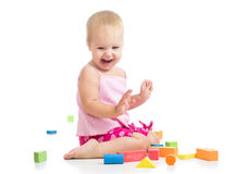 Child girl playing with toys Stock Photo