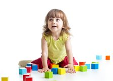 Child girl playing toys Stock Images