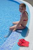 Child girl playing in tropical pool Stock Photos