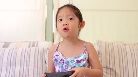 Child, Girl, Playing Video Game or VDO Game stock video
