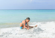Child girl playing on white sand gorgeous beach near the ocean Royalty Free Stock Photography