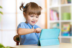Free Child Girl Playing With A Digital Tablet At Home Stock Photos - 60703403