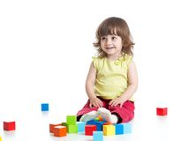Child girl playing wooden toys Stock Photo