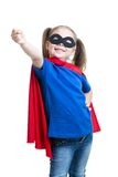 Child girl plays superhero Royalty Free Stock Image