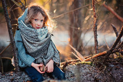 Child Girl Plays With Pine Cones On Tree Log In Winter Forest Stock Images