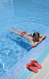 Child girl in pool Stock Photography
