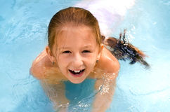 The child the girl  in the pool Royalty Free Stock Photos