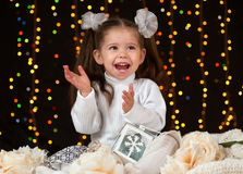 Child girl portrait in christmas decoration, happy emotions, winter holiday concept, dark background with illumination and boke li. Ghts royalty free stock photo