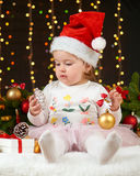 Child girl portrait in christmas decoration, happy emotions, winter holiday concept, dark background with illumination and boke li Royalty Free Stock Photography