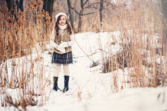 Child girl portrait on cozy warm outdoor winter walk Stock Image