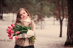 Child girl portrait with flowers on cozy warm outdoor winter walk Stock Photography