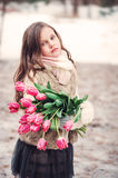 Child girl portrait with flowers on cozy warm outdoor winter walk Stock Image