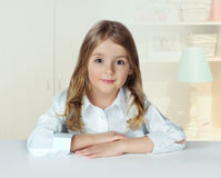 Child girl portrait indoor home.Pupil female at table.Lifestyle. Royalty Free Stock Photos
