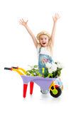 Child girl with potted flowers and gardening equipment Royalty Free Stock Photography