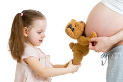 Child girl and pregnant mother's stomach Royalty Free Stock Images