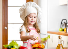 Child girl preparing healthy food Stock Photo
