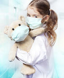 Child girl protective mask virus protection concept. Royalty Free Stock Images