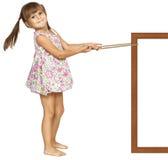 Child girl pulling frame. Isolated on white Stock Images
