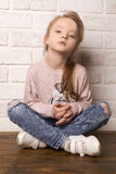 Child Girl in ragged jeans and sneakers Royalty Free Stock Image
