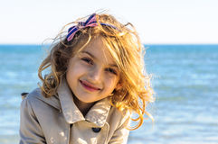 Child girl in raincoat portrait Stock Image