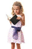 Child girl reading a book Royalty Free Stock Images