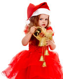 Child girl in red santa hat with christmas bell. Royalty Free Stock Photo
