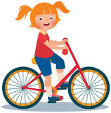 Child girl rides a bike Royalty Free Stock Image