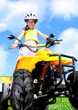 Child girl rides on quad Stock Photography