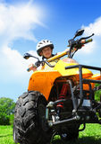 Child girl rides on quad Royalty Free Stock Image
