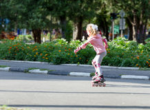 Child girl roller skating Royalty Free Stock Images