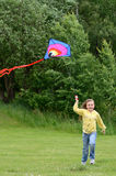 Child girl runs with kite Stock Photos
