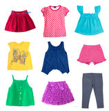 Child girl's fashion summer clothes set isolated on white. Fashion colorful diferent child girl clothes summer collage.Fashion kid's wear set isolated on white Royalty Free Stock Images