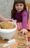 Child girl's help with making cake Royalty Free Stock Photography