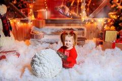 Child girl sculpts snowman stock photos