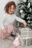 Child girl with sheep toy and gifts at Christmas Royalty Free Stock Image