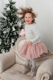 Child girl with sheep toy jump at Christmas Stock Photography