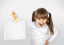 Child girl with shopping bags. Portrait of shouting child girl with shopping bag Stock Image
